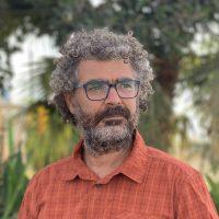 Dr. Tamir Caras